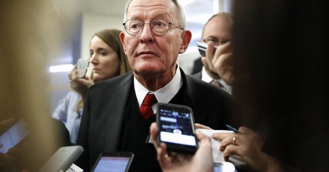 The Latest: 2 senators formally propose health deal