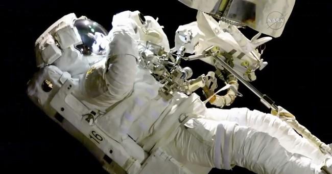 The Latest: Spacewalker's jetpack bad; ordered back inside