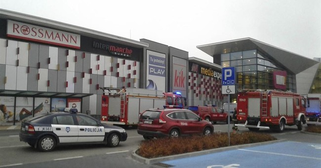 The Latest: Polish police: No terror motive in mall attack