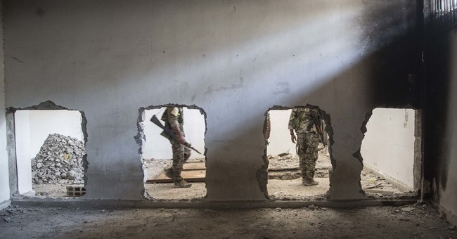 US official: IS burrowing for footholds from Asia to Africa