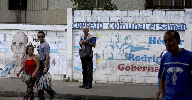 In gritty city outside Caracas, the story of a socialist win