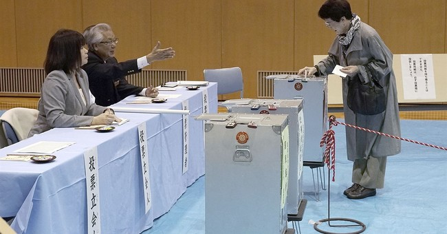 The Latest: Japan ruling bloc retains two-thirds majority