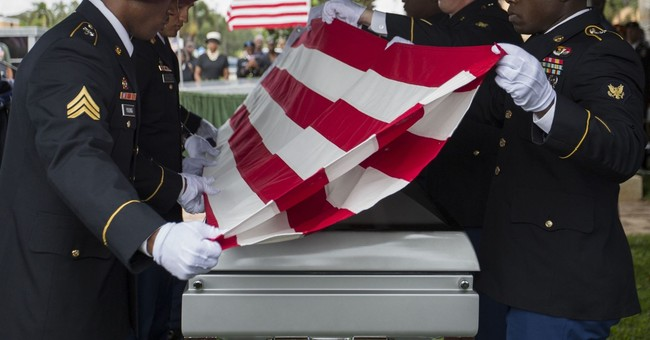 Funeral held for US soldier at center of Trump fight
