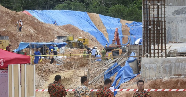Landslide in northern Malaysia kills 3; 11 more trapped