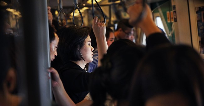 Bangkok returns to mourning colors, but what of the future?