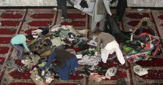 The Latest: Pakistan condemns mosque attacks in Afghanistan