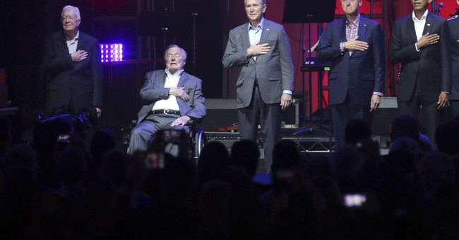The Latest: Appeal backed by former presidents raises $31M