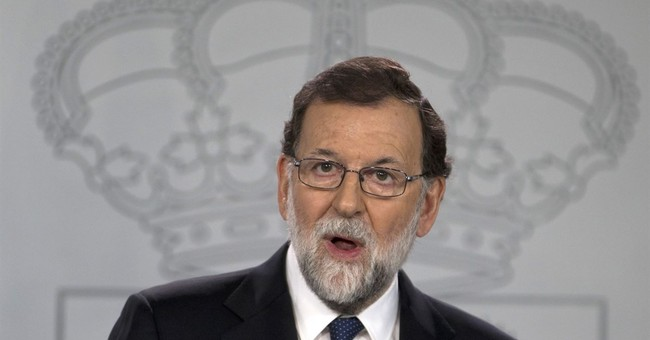 Spanish leader moves aggressively to clip Catalonia's wings