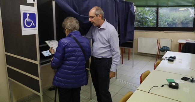 The Latest: Lombardy chief says 95% vote 'yes' for autonomy