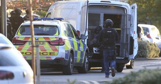 Gunman arrested after taking hostages at UK bowling alley