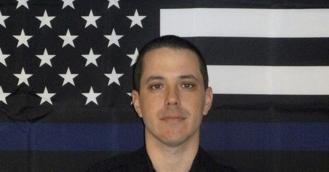 Police officer fatally shot at domestic dispute call