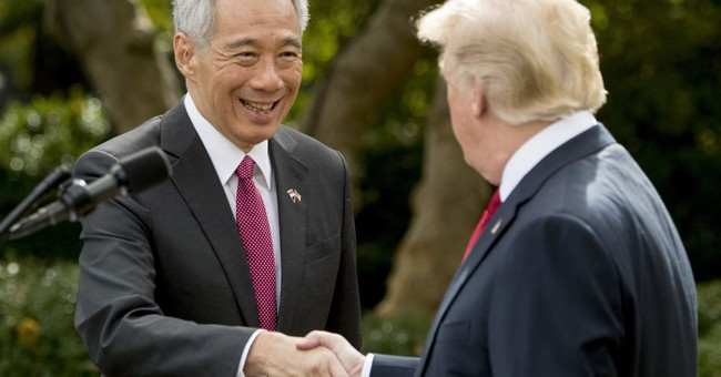 In Asia, Trump to warn North Korea but not likely visit DMZ