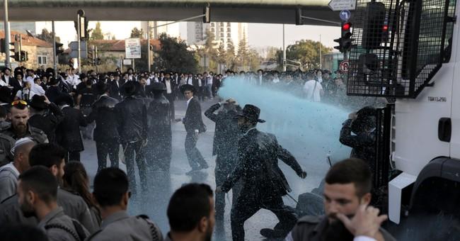 Ultra-Orthodox Jews block Jerusalem roads in draft protests