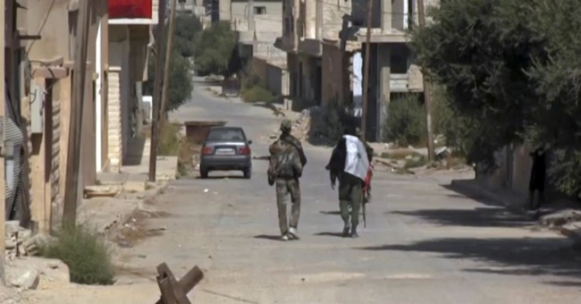 The Latest: IS militants came to Syrian town with hit list