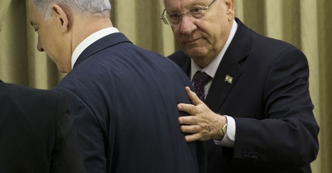 After speech, Israeli president termed 'Nazi' in graffiti