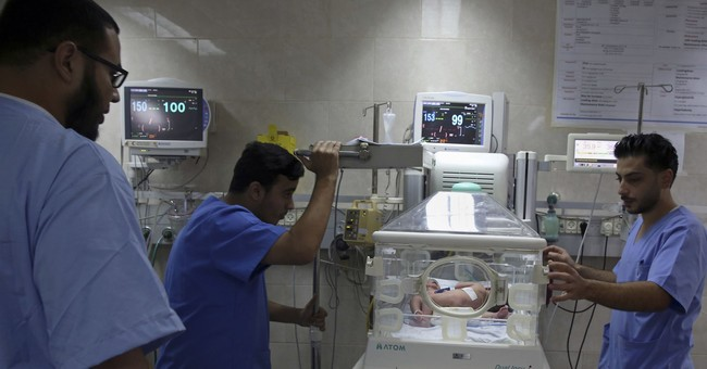 Doctor: Conjoined twins born in Gaza will need care abroad