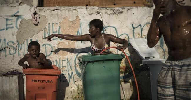 AP PHOTOS: Hard life, smiles, in abandoned Rio building