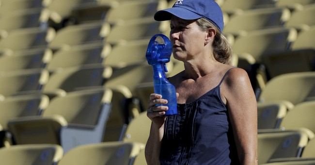 The Latest: Crews battle fires amid Southern California heat