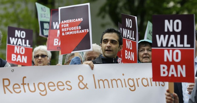 Trump allows refugee admissions to resume with new screening