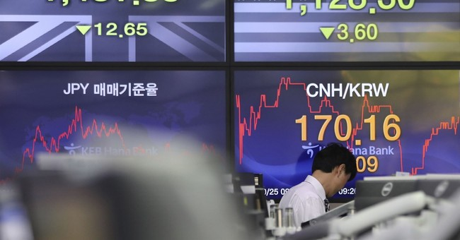 Global stocks mixed amid strong corporate earnings