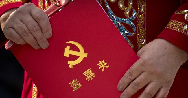 Xi's status lifted, setting stage for an even tighter grip