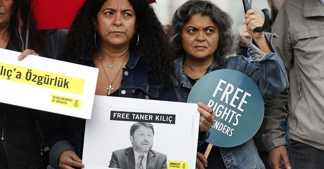Court rules Amnesty's Turkey chief to remain jailed