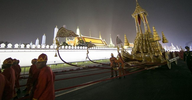 The Latest: Thai royals lead funeral procession for king