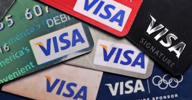 Visa 4Q profits rise 11 percent, beating analyst forecasts