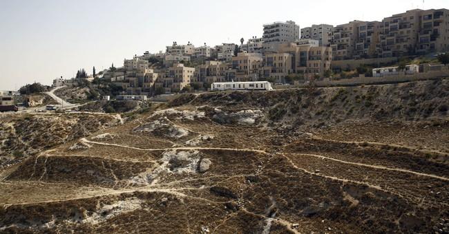 Israel approves settlement homes in east Jerusalem