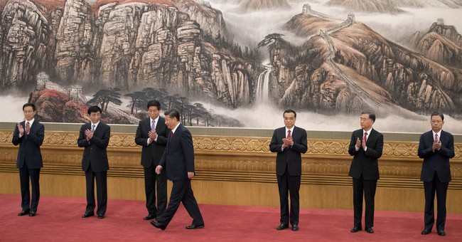 China's Xi unveils new party leaders but no clear successor
