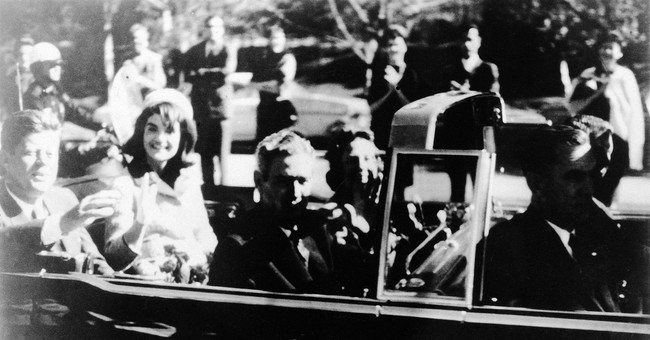 The Latest: Archives release some long-secret JFK files