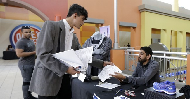 Applications for US jobless aid up modestly from 44-year low