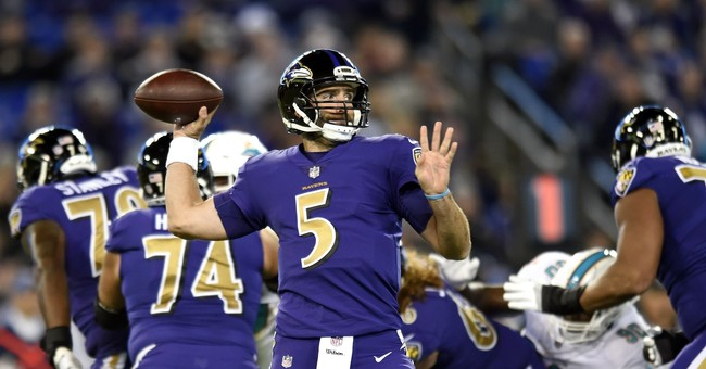Ravens lose Flacco, beat Dolphins 40-0 behind defense