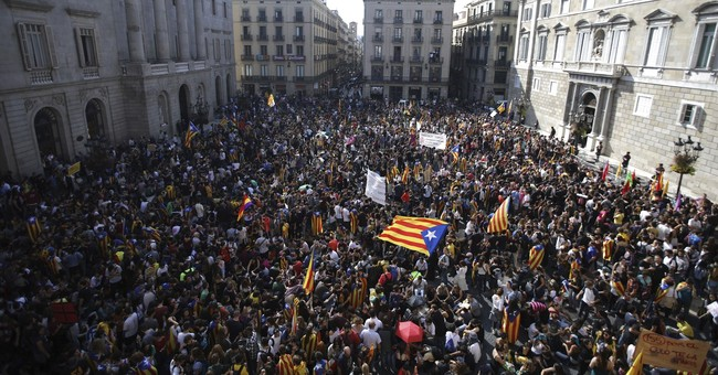 The Latest: Spain panel passes takeover plan for Catalonia