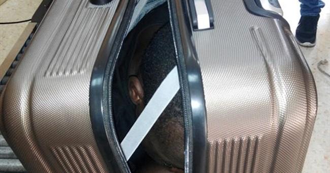 Border guards in Spain find migrants hidden in suitcase, car