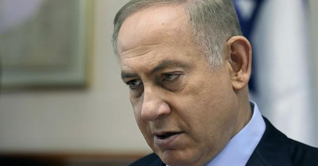 Israeli leader denies wrongdoing after police grilling
