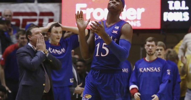 Jayhawks' Bragg charged in drug possession case