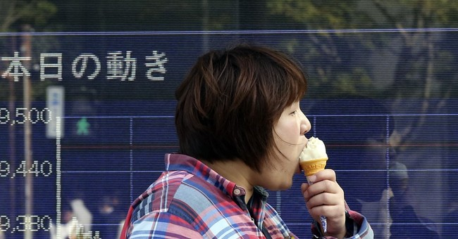 Asian stocks fall, taking cue from Wall Street on travel ban