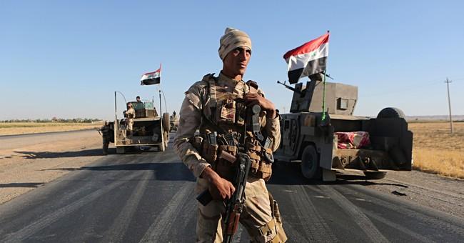 Iraq halts troops tasked to retake land from Kurdish control