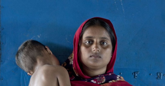 AP PHOTOS: Portraits of Rohingya survivors of capsized boat