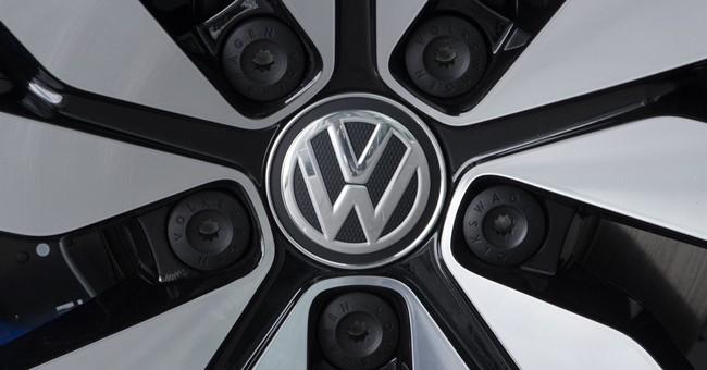 Volkswagen raises profit forecast despite diesel charges