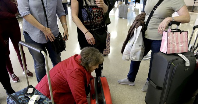 New questions and searches greet travelers flying to the US