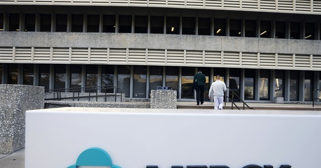 Merck swings to 3Q loss on big charge but raises forecast