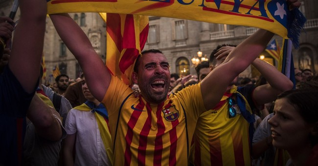 The Latest: Hundreds against independence rally in Barcelona