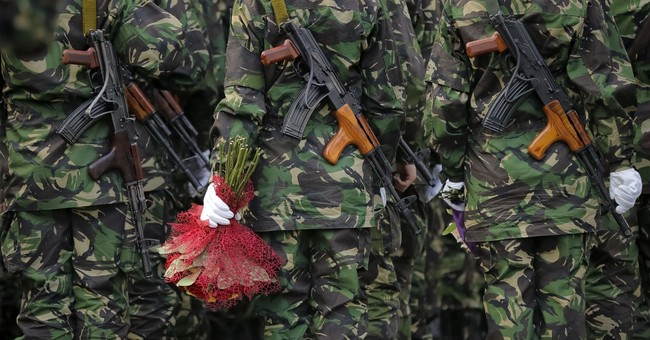 AP PHOTOS: Romania honors its military with Army Day