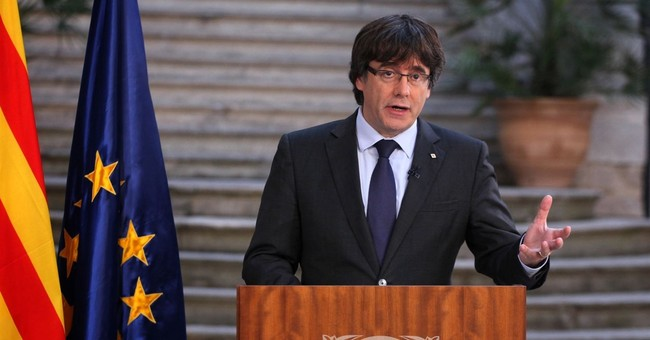 Ousted Catalan leader vows peaceful resistance to Spain