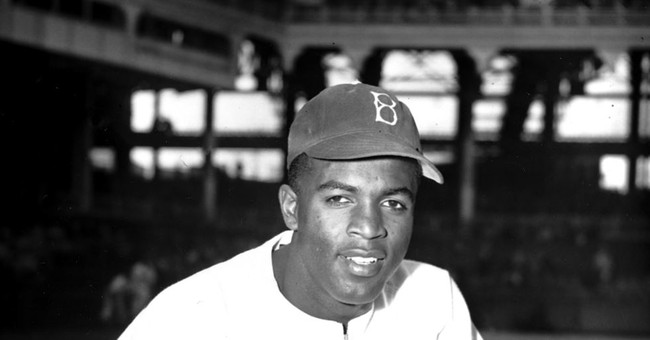 Jackie Robinson's padded cap sells for $590K at auction