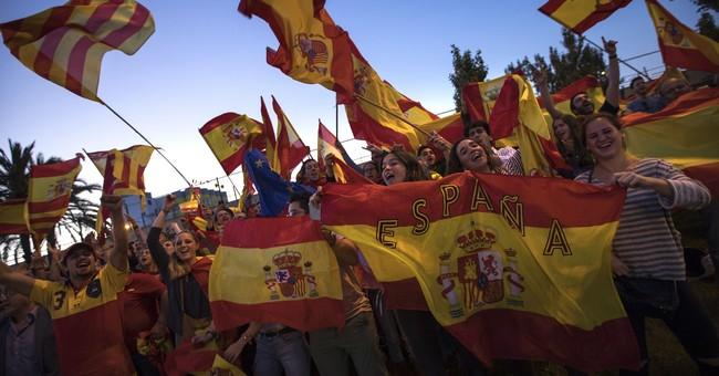 The Latest: European Parliament ex-chief defends Spain