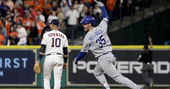 The Latest: Astros take wild Game 5, take 3-2 lead to LA