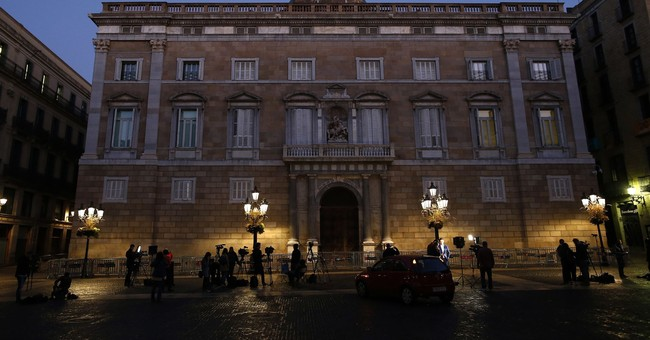The Latest: Lawyer says no decision by Puigdemont on asylum